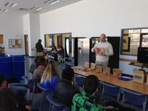 OWC Ryan shows the evolution of OWC's packaging materials to Crystal Lake Central students.