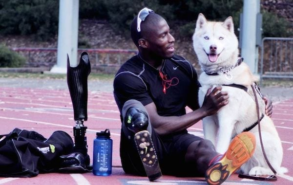 Buddy Time: Kionte takes a break from practice to spend some quality time with his best friend, Koja. Since 2011, Kionte and Koja, a Siberian Husky service dog, have been almost inseparable. Kionte says Koja helps him through the rough periods and celebrates with him with each achievement.