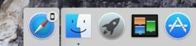 Safari handoff icon to the left of the Finder icon in the Dock