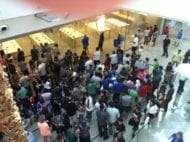 A crowd of people wait to enter the Apple store at the Mall at Millenia. (Red Huber, Orlando Sentinel )