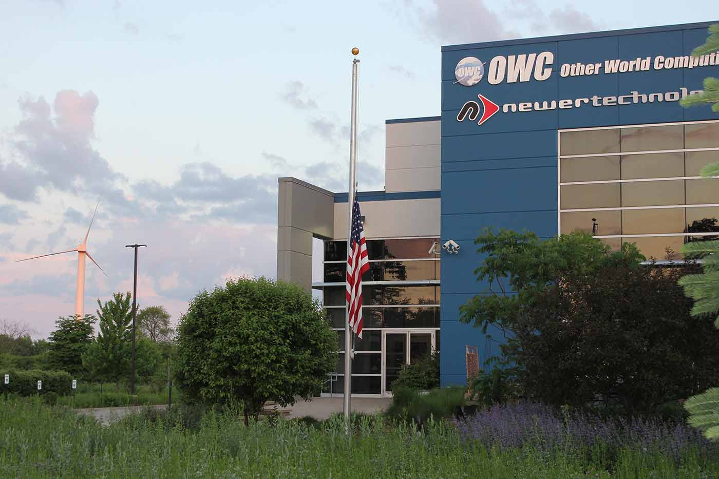 The American Flag lowered to half-mast at dawn at OWC headquarters in Woodstock, IL.