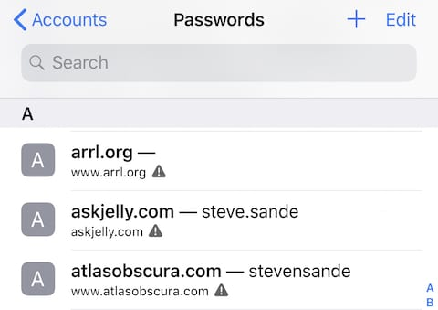In iCloud Keychain, accounts using the same password are highlighted with a warning triangle