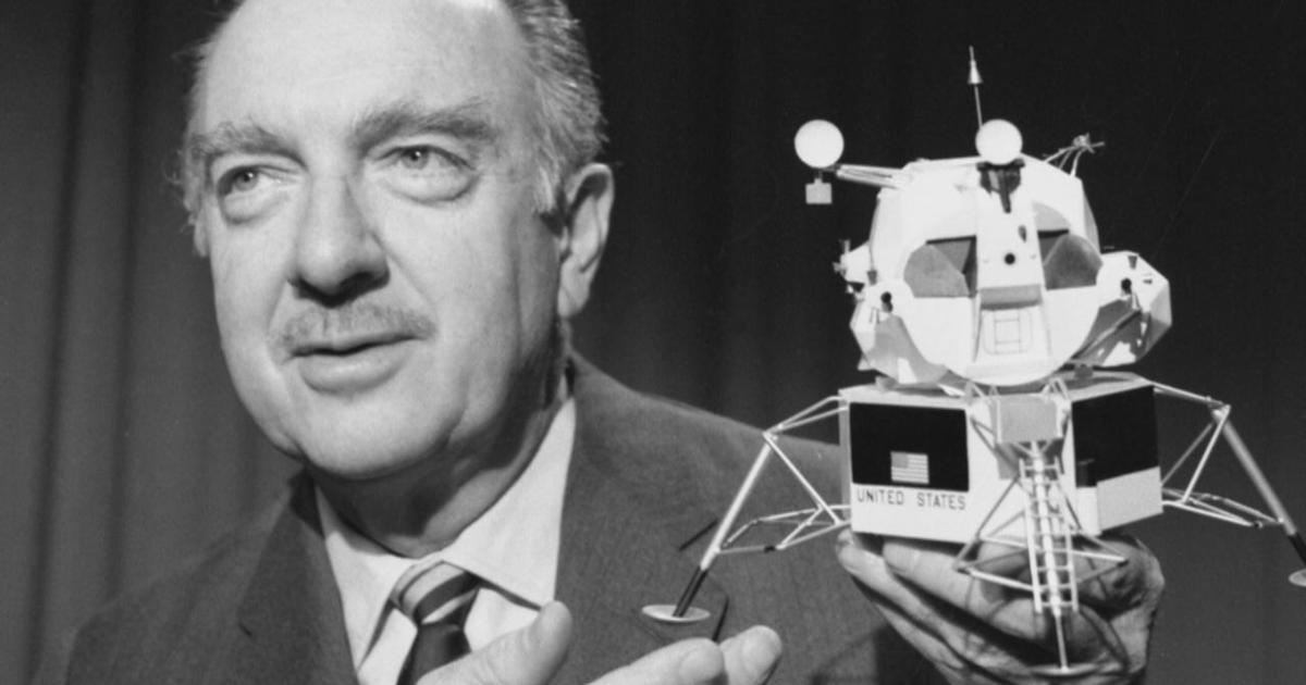 Walter Cronkite with a model of the Lunar Module. Photo via CBSNews.com