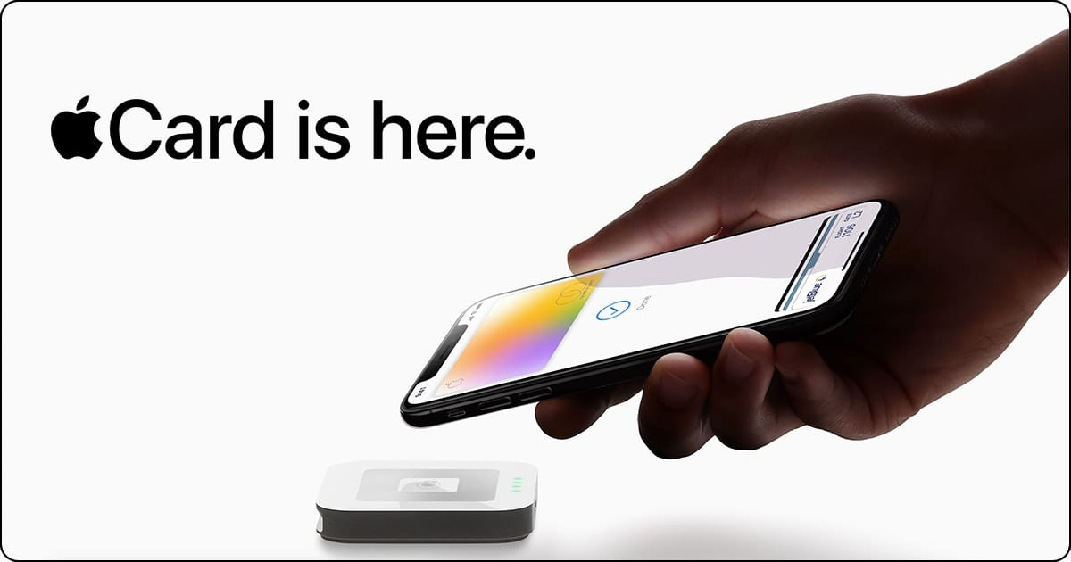 Apple Card is here with hand holding phone paying with Apple card