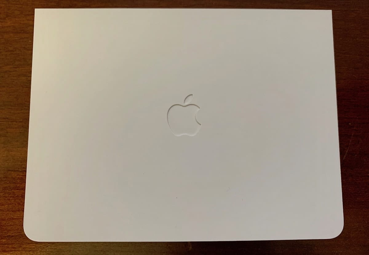 The folder in which the Apple Card is packaged, complete with cutout Apple logo