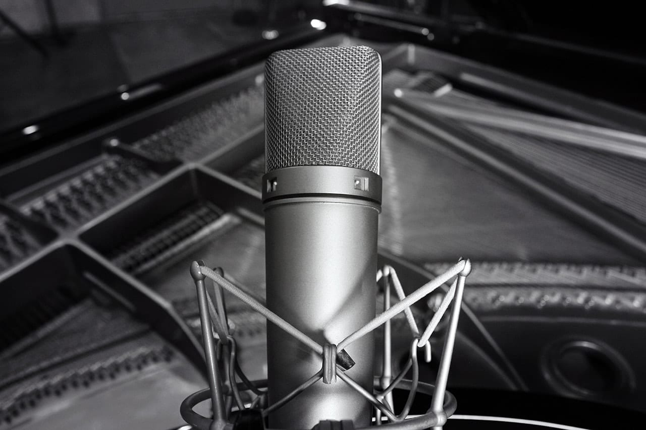 Black and White photo of a Neumann U87 Condenser Microphone