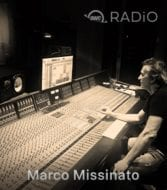 Marco Missinato sitting at a recording console