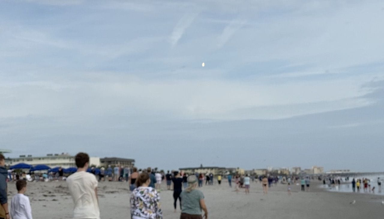 The bright dot at center is the Falcon 9 lofting towards its planned destruction as seen from Cocoa Beach. Photo from a video by Steve Sande.