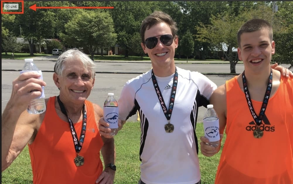 A father and two sons holding water bottles after a run