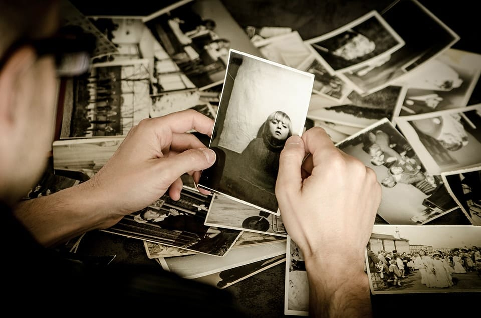 Picture of someone looking through black and white photos