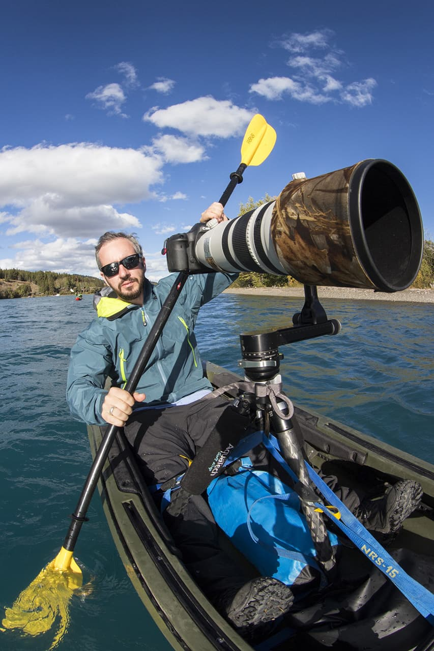 Photograph of Dan Carr in a kayak wiith his camera