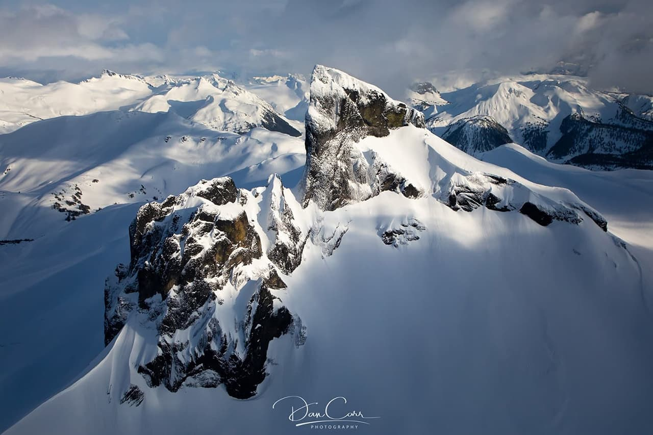 Ariel photo of a snow-capped mountains. Photographed by Dan Carr.