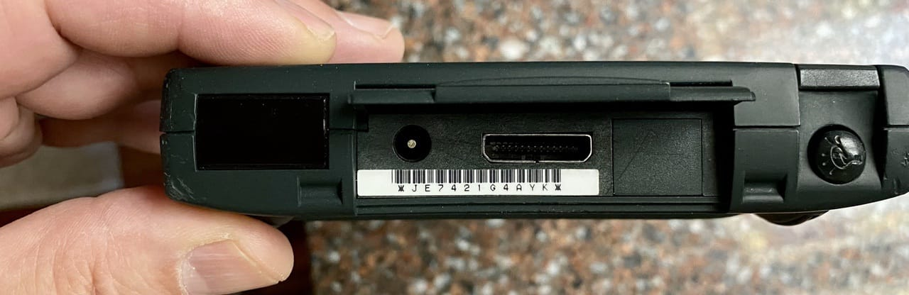 The IrDA Infrared transceiver (left), power port, Newton Interconnect Port, and stylus silo (right)