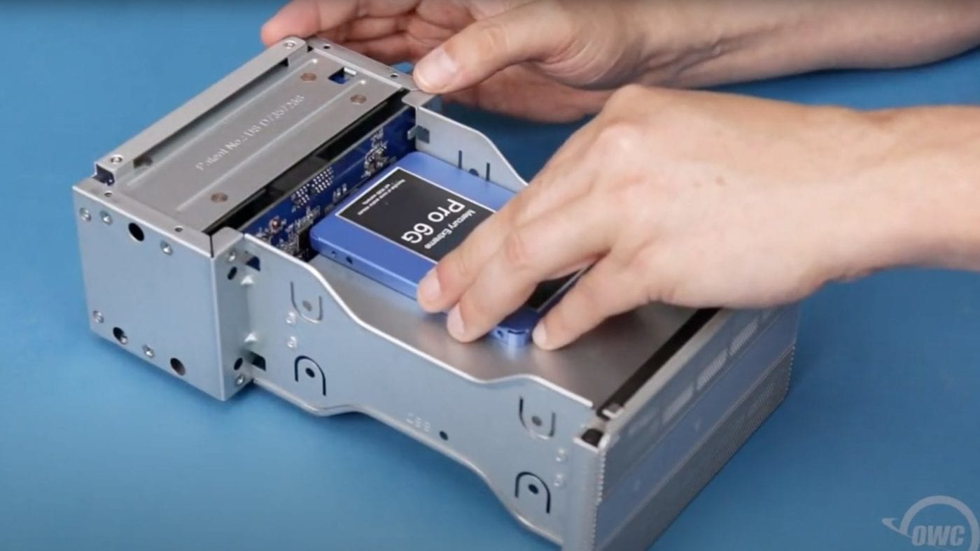 SSD being installed into an OWC Mercury Elite Pro Dual
