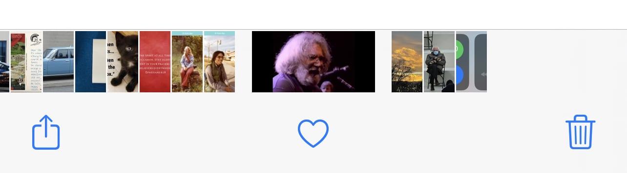 The Photos app share button at far left, bottom.