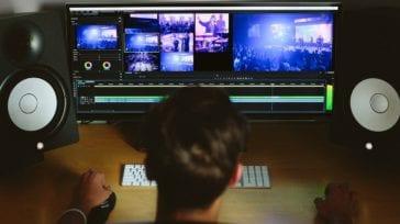 A man at a computer editing video