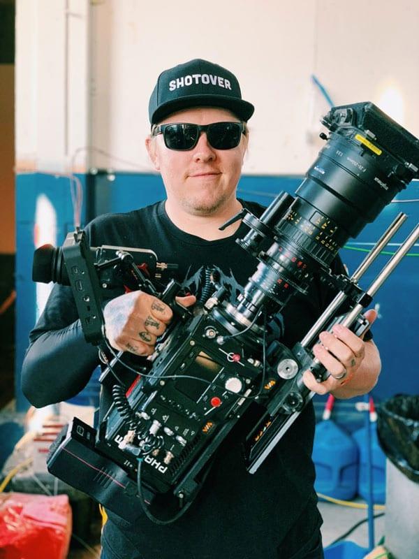 Chris Vanderschaaf posing with his Phantom high-speed camera