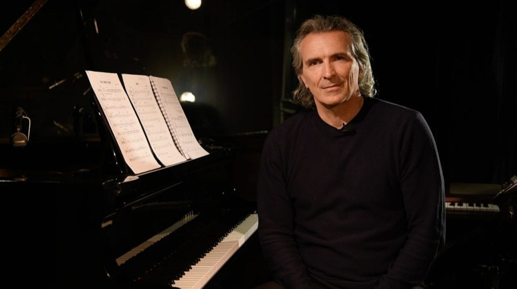 Marco Missinato sitting at piano